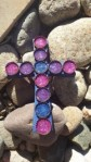 cross with bottle caps and purple glitter craft