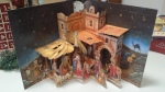 advent calendar pop-up open shows nativity scene three dimensional